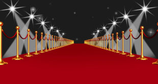 Red Carpet Event Walk with Spotlights Against Black Background